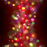Festive Christmas background with lights. Flickering multi-colored lights on  dark background Stock Photos