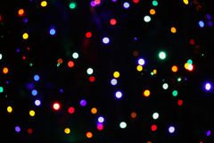 Festive christmas background with natural bokeh bright colorful lights Stock Photos