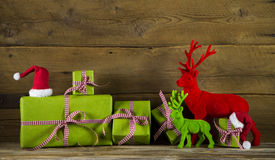 Festive christmas background with presents and reindeer in red a stock photo