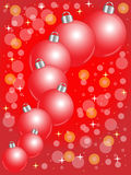 Festive Christmas Background. Red Christmas balls on red background Stock Photo
