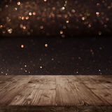Festive Christmas background with shimmering light. And bokeh in front of a wooden table royalty free stock photography