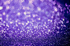 Festive Christmas background with stars. Abstract twinkled brigh. T background with bokeh defocused lights Royalty Free Stock Photo