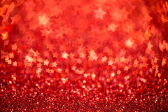 Festive Christmas background with stars. Abstract twinkled bright background with bokeh defocused lights Royalty Free Stock Image