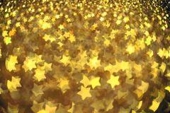 Festive Christmas background with stars. Abstract twinkled bright background with bokeh defocused lights Royalty Free Stock Images