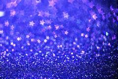 Festive Christmas background with stars. Abstract twinkled bright background with bokeh defocused lights Stock Photo