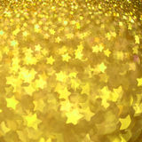Festive Christmas background with stars. Abstract twinkled bright background with bokeh defocused lights Stock Image