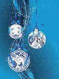 Blue Floral Christmas Ball. Festive christmas ball decorated with blue floral ornaments Royalty Free Stock Photo