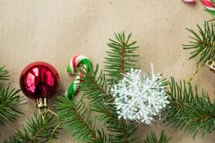 Festive christmas border with red and silver balls on fir branches and snowflakes on rustic beige background. With copyspace royalty free stock image