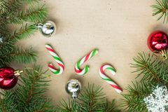 Festive christmas border with red and silver balls on fir branches and snowflakes on rustic beige background. With copyspace and pen royalty free stock photos