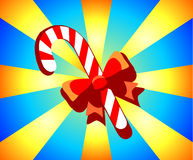 Festive Christmas candy on blue-yellow background.  Royalty Free Stock Image