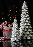 Festive Christmas candy canes and trees Royalty Free Stock Images