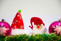 Two pink christmas balls,toy Santa and Christmas decoration on a white background. Festive, Christmas card,pink balls,toy Snta and Christmas decorations on a Royalty Free Stock Images