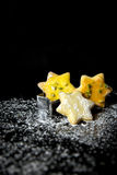 Festive christmas card with star cookies and icing sugar on a bl Stock Image