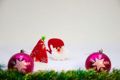 Pink christmas balls, Santa Claus, and Christmas decoration on a white background. Festive, Christmas card with toy Santa Claus, with pink balls and Christmas Stock Photo