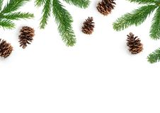 Festive Christmas Composition With Pine Cones and Fir Branches. Festive Christmas layout composition, top view with fir tree branches and pine cones on a white Stock Photo