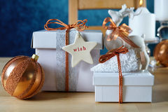 Festive Christmas Copper and White Gifts Stock Photo