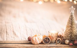 Festive Christmas cozy atmosphere with home decor. And tangerines on a wooden background, home comfort concept royalty free stock photography