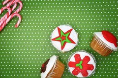 Festive Christmas cupcakes Stock Photos