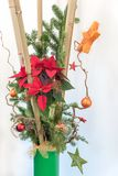 Festive christmas decoration with bamboo cane and poinsettia Royalty Free Stock Photography
