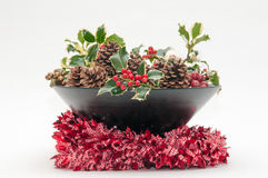 Festive Christmas decoration with holly and ivy on a white backg Stock Photo