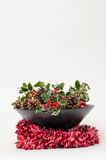 Festive Christmas decoration with holly and ivy on a white backg Royalty Free Stock Image