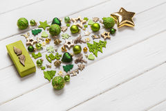 Festive christmas decoration in light green, white and golden co. Lor. Collection of xmas miniatures Stock Photography
