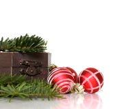 Festive Christmas decoration set. With ornamental balls, tree branches and retro box Stock Photo