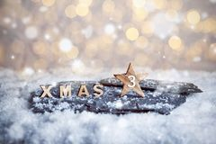 Third Advent Sunday and wooden XMAS letters in snow royalty free stock photos