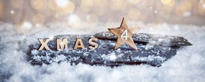 Fourth Advent Sunday and wooden XMAS letters in snow stock image