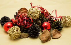 Festive Christmas Decorations. Festive Christmas arrangement with baubles and pine cones Stock Photos