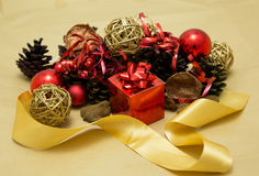 Festive Christmas Decorations. Festive Christmas arrangement with baubles and pine cones Stock Image
