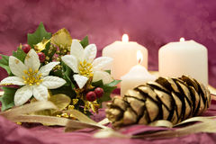 Festive Christmas Decorations. With candles,flowers,and gold pine cone Royalty Free Stock Photos