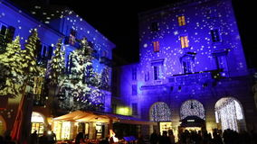 Festive Christmas decorations on facades of buildings in Como, Italy stock footage