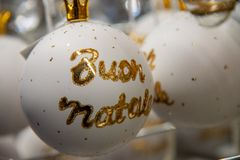 Christmas decorations.White decorative balls for Christmas trees with Italian words `Merry Christmas` royalty free stock image