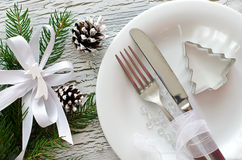 Festive christmas dinner tableware with white plate Stock Photo