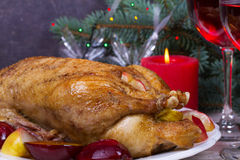 Festive Christmas duck baked with apples and plums: glasses of wine. Stock Images