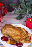 Festive Christmas duck baked with apples and plums: glasses of wine. Royalty Free Stock Photos
