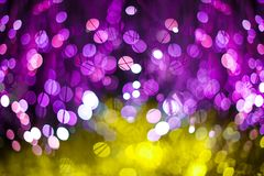 Festive Christmas elegant abstract background with Purple and Neon bokeh lights and stars royalty free stock image
