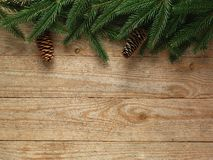 Festive Christmas fir tree on wooden background with space for your text Stock Photos