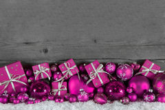 Festive christmas frame: wooden background with pink presents an