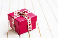 Festive Christmas gift with ribbon Royalty Free Stock Photos