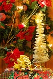 Festive Christmas gifts and golden tree. Celebrating the magic of Christmas with festive gifts and golden lights tree royalty free stock photo