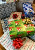 Festive Christmas gifts stacked under the tree royalty free stock image
