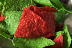 Festive Christmas Green and Red Tortilla Chips Stock Image