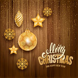 Festive Christmas Greeting Card. Festive Christmas Luxury Design with Golden Christmas Decorations on Wooden Background. Calligraphy Inscription Merry Christmas Royalty Free Stock Photography