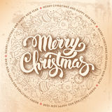 Festive Christmas Greeting Card. Festive Christmas and New Year Rounded Design with Calligraphic Inscription Merry Christmas and Different Christmas Objects in Stock Images