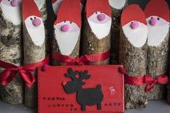Festive Christmas hand made log Santa`s in Scotland. Stock Photography