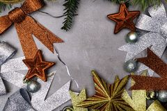 Festive Christmas Happy Holidays background with decorated borders with red star, bows, and branch. Festive Christmas Happy Holidays background with decorated stock photo