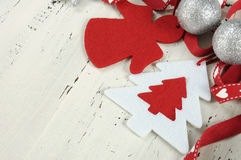 Festive Christmas Holiday background with red and white theme felt ornaments - closeup Stock Images