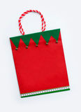 Festive Christmas Holiday Gift Bag. With Jingle Bells isolated on white background Royalty Free Stock Photos